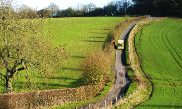 photo of a bus travelling through the countryside